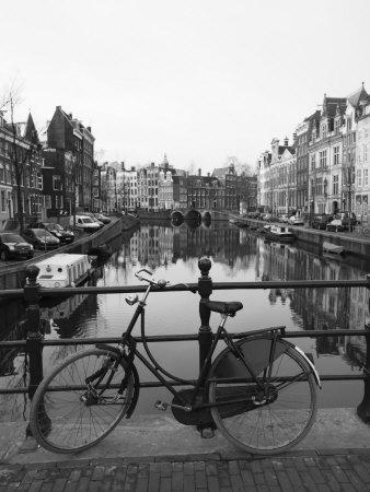 Black and White Image of an Old Bicycle by the Singel Canal, Amsterdam, Netherlands, Europe