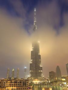 Burj Khalifa Illuminates the Clouds and Surrounding Skyline at Night, Downtown, Dubai, Uae by Amanda Hall