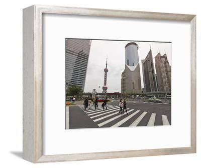 Pedestrian Crossing in Pudong, the Financial and Business Centre. Oriental Pearl Tower in Centre, S