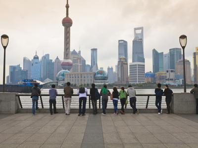 People Viewing the Pudong Skyline and the Oriental Pearl Tower from the Bund, Shanghai, China, Asia by Amanda Hall