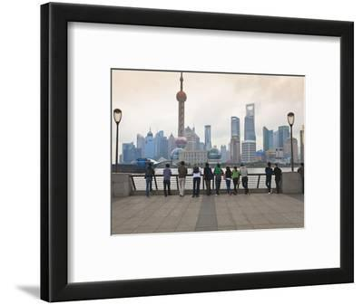 People Viewing the Pudong Skyline and the Oriental Pearl Tower from the Bund, Shanghai, China, Asia