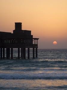 Pier at Madinat Jumeirah Hotel at Sunset, Dubai, United Arab Emirates, Middle East by Amanda Hall