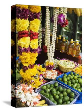 Stall Selling Fruit and Flower Garlands for Temple Offerings, Southeast Asia