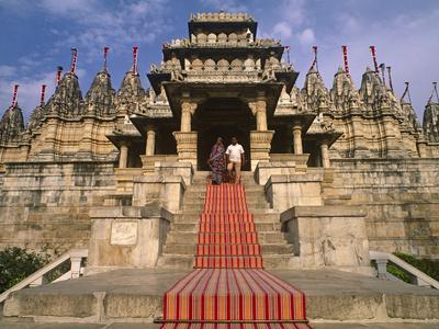 India, Rajasthan, Ranakpur, a Couple Descend Steps at the Famous Chaumukha Mandir, an Elaborately S