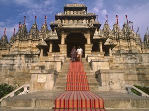 India, Rajasthan, Ranakpur, a Couple Descend Steps at the Famous Chaumukha Mandir, an Elaborately S by Amar Grover