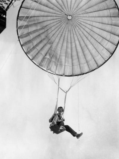 Amelia Earhart Helps Test a Commercial Parachute. June 2, 1935--Photo