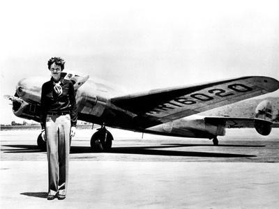 Amelia Earhart Standing in Front of the Lockheed Electra in Which She Disappeared in July 29, 1937--Photo