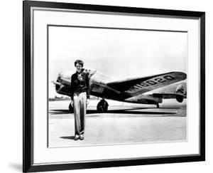 Amelia Earhart Standing in Front of the Lockheed Electra in Which She Disappeared in July 29, 1937