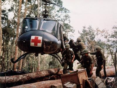 """American 4th Battalion, 173rd Airborne Brigade Soldiers Loading Wounded Onto a """"Huey"""" Helicopter-Alfred Batungbacal-Photographic Print"""