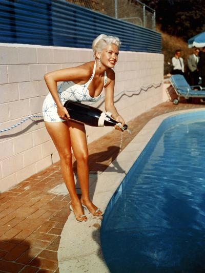 American Actress Jayne Mansfield with a Bottle of Champagne, Near a Swimming Pool, 1956-1957--Photo