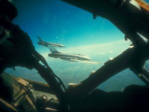 American F-100 Firing Bullpup Missile at Target During Vietnam War Air Mission
