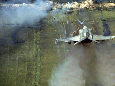 American F4C Phantom Jet Firing Rockets into Viet Cong Stronghold village During the Vietnam War-Larry Burrows-Photographic Print