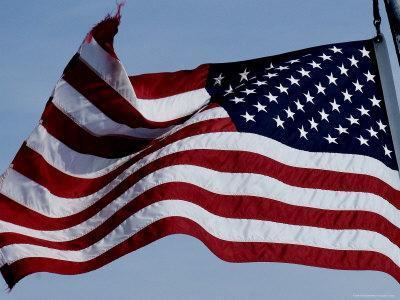 https://imgc.artprintimages.com/img/print/american-flag-waving-in-the-breeze_u-l-p2vakb0.jpg?p=0