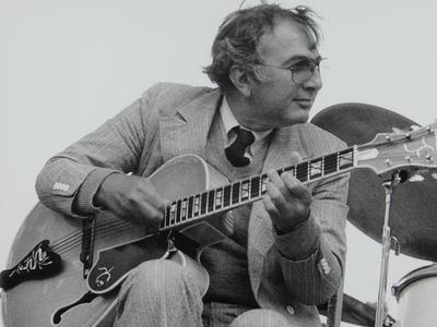 https://imgc.artprintimages.com/img/print/american-guitarist-bucky-pizzarelli-on-stage-at-the-capital-radio-jazz-festival-london-1979_u-l-q10m54m0.jpg?p=0