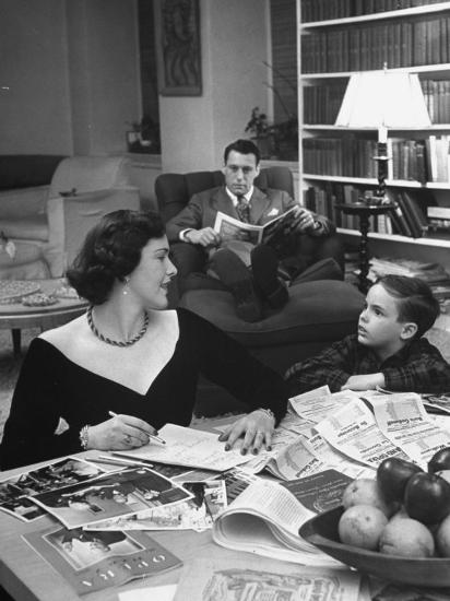 American Housewife Margaret Carson Sitting at Home with Her Husband and Son-Nina Leen-Photographic Print