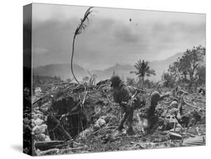 American Marine Hurls Hand Grenade Towards Japanese Position as His Partner Prepares to Do the Same