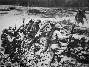 American Infantry in WWI Leaving their Trench to Advance Against the Germans, 1918 by American Photographer