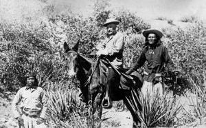 General George Crook on a Mule, with Two Apache in Arizona, 1882 by American Photographer