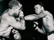 Young Cassius Clay Scores with a Left Against the Veteran Archie Moore in the First Round of the?-American Photographer-Photographic Print