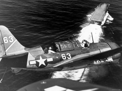 American SB2C Scout Plane Circling Above an Aircraft Carrier Prior to Landing--Photographic Print