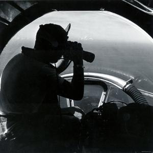 American Serviceman in Nose of B17 Using Binoculars to Scan Ocean During Air Sea Rescue Mission