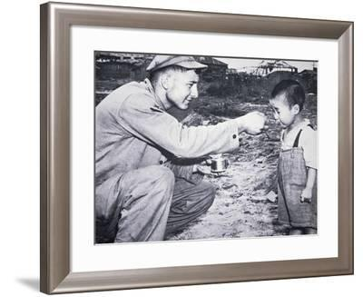 American Soldier Shares His Rations with South Korean Child--Framed Photographic Print