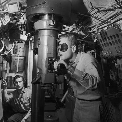 American Submarine Captain Peering Through Ship's Periscope Searching for Japanese Shipping--Photographic Print