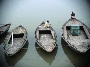 Boats on Ganges River , Varanasi, India by Ami Vitale
