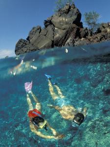 Couple Snorkeling by Amos Nachoum