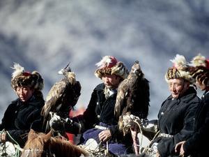 Eagle Hunters at the Golden Eagle Festival, Mongolia by Amos Nachoum