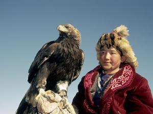 Youngest Eagle Hunter in the Festival, Talgat, Golden Eagle Festival, Mongolia by Amos Nachoum