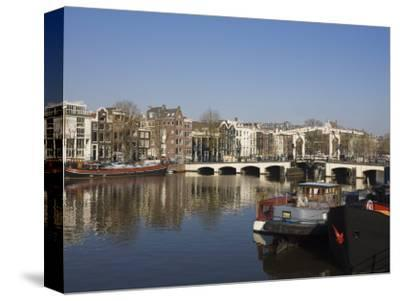 Amstel River and Magere Bridge, Amsterdam, Netherlands, Europe-Amanda Hall-Stretched Canvas Print