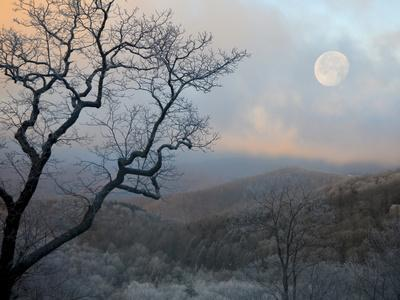 A Nearly Full Moon Sets over the Blue Ridge Mountains at Sunrise