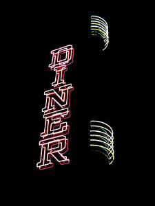 The Neon Lights of a Diner Sign Shine Bright Against the Black Night by Amy & Al White & Petteway