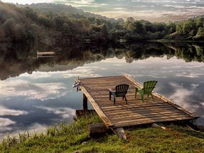 Two Chairs on a Small Dock on a Calm Lake with Cloud Reflections by Amy & Al White & Petteway