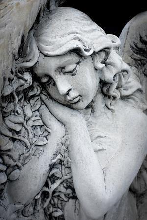 Close Up of a Garden Statue of an Angel