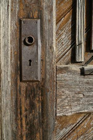 Detail of a Weathered Door and a Rusty Door Plate