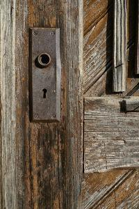 Detail of a Weathered Door and a Rusty Door Plate by Amy and Al White and Petteway