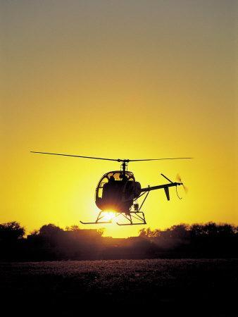 Helicopter with Sun Setting
