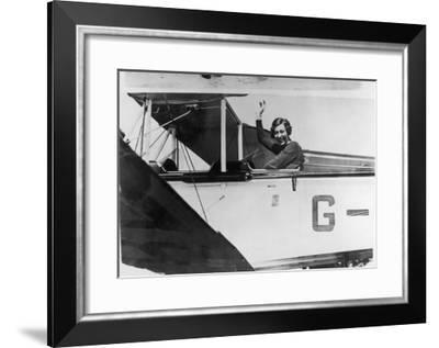 Amy Johnson (Mrs Mollison) Sits in Her Plane and Smiles and Waves to the Camera--Framed Giclee Print