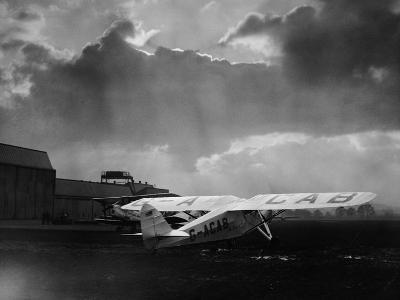 """Amy Johnson's """"The Desert Cloud"""" Preparing for Take Off--Photographic Print"""