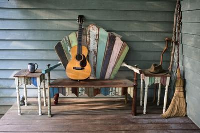 A 1931 Martin 0-28 Guitar Rests on a Re-Purposed Furniture Bench on a Front Porch by Amy White and Al Petteway