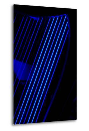 Blue Light Shining Through the Strings of a Celtic Harp on Stage before a Concert