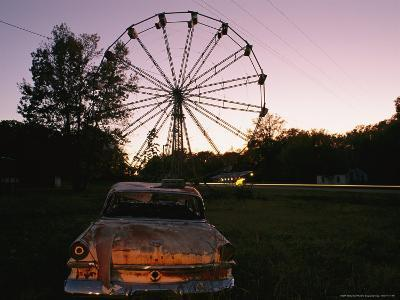 An Abandoned Amusement Park at Twilight-Randy Olson-Photographic Print
