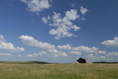 An Abandoned Barn in a Vast Field under a Sky with Puffy Clouds-Michael Forsberg-Photographic Print