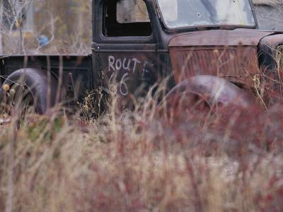 An Abandoned Old Truck Sits in a Field of Autumn Colored Grasses-Roy Gumpel-Photographic Print