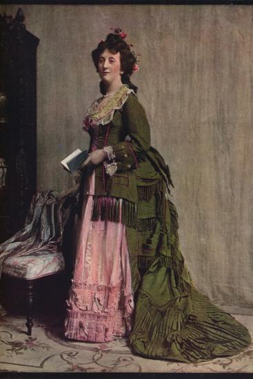 'An afternoon dress of green and pink silk. Very typical of the modes between 1868 and 1878', c1913-Unknown-Photographic Print