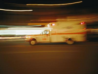An Ambulance Rushes Past at Night-Stephen St^ John-Photographic Print