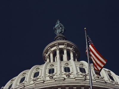 An American Flag and the Statue of Freedom Atop the Capitol Dome-Medford Taylor-Photographic Print