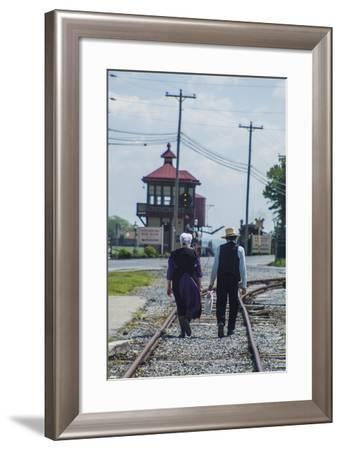 An Amish Couple Walk on Railroad Tracks Toward the Strasburg Railroad Station-Richard Nowitz-Framed Photographic Print